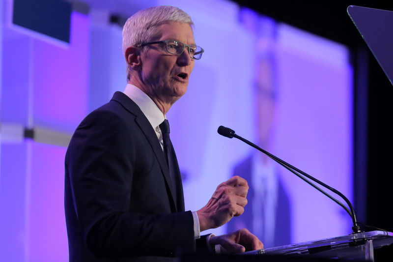 Apple services business grows; CEO Cook says China tensions ease