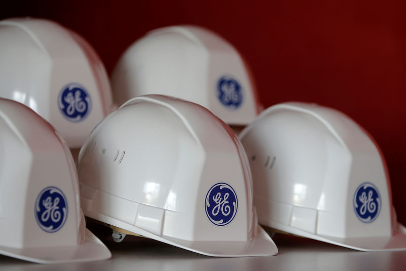 © Reuters. FILE PHOTO: General Electrica's logo is shown at work kits during a visit to the General Electric power plant in Montoir-de-Bretagne