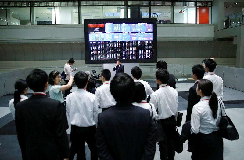 Asian stocks extend gains on firm Wall Street; dollar steady