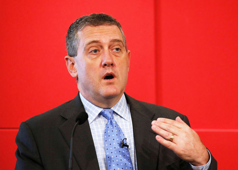 © Reuters. FILE PHOTO - St. Louis Fed President James Bullard speaks at a public lecture on