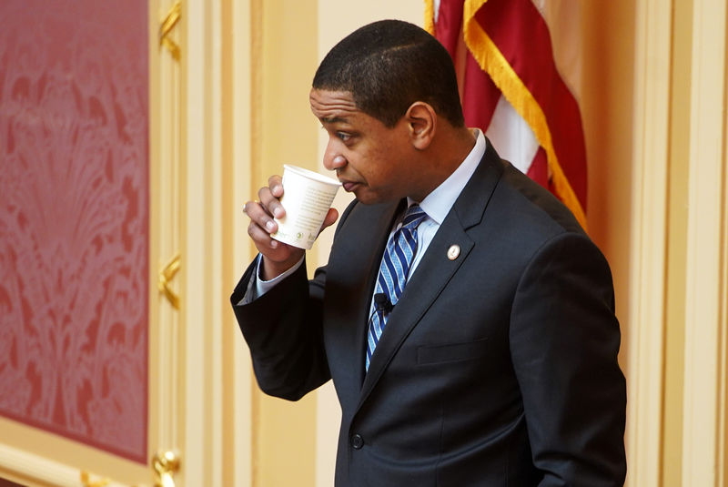© Reuters. Justin Fairfax, the Lieutenant Governor of Virginia, drinks before opening the state's Senate meeting during a session of the General Assembly in Richmond