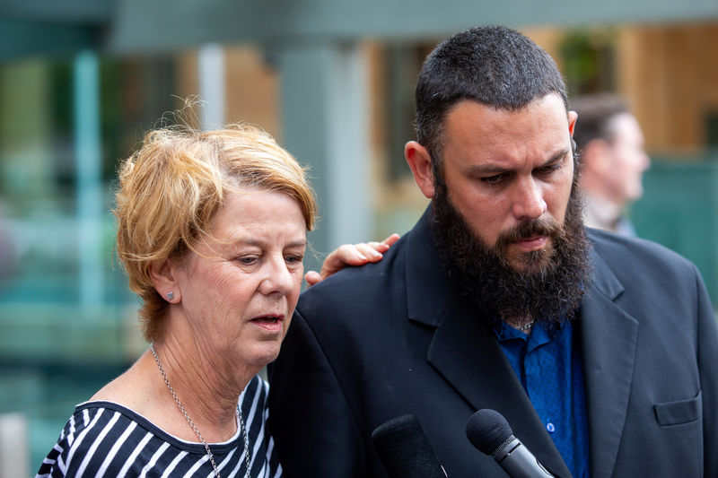 © Reuters. Barbara Spriggs and son Clive Spriggs speak to the media after giving evidence at the Royal Commission into Aged Care, Commonwealth Courts in Adelaide