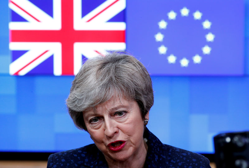 © Reuters. FILE PHOTO: British PM May speaks to the press at the European Council headquarters in Brussels