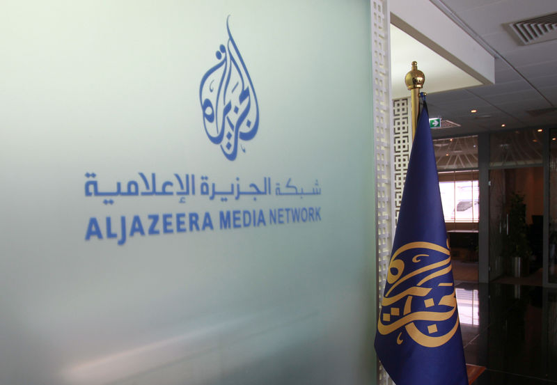 © Reuters. Al Jazeera logo seen inside HQ in Doha