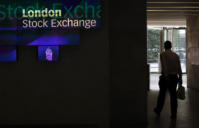 © Reuters. FILE PHOTO:  A man walks through the lobby of the London Stock Exchange