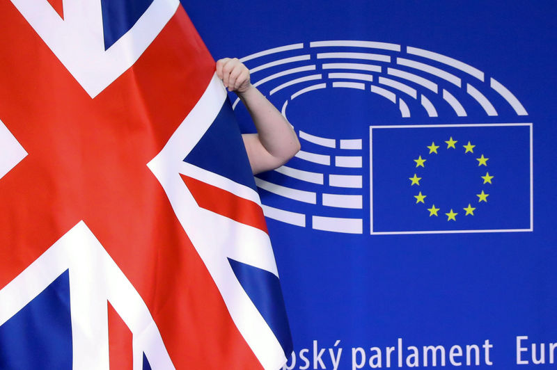 © Reuters. Union Jack flag is adjusted EU Parliament in Brussels