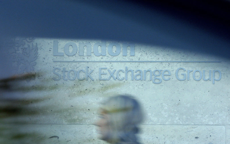 © Reuters. FILE PHOTO:  A woman is seen through a car window as she walks past the London Stock Exchange