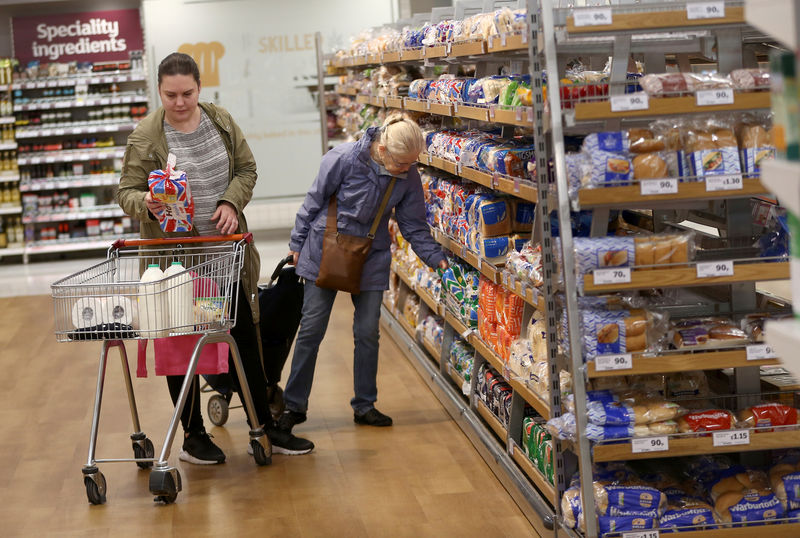 © Reuters. FILE PHOTO: People shop at a Sainsbury's store in London