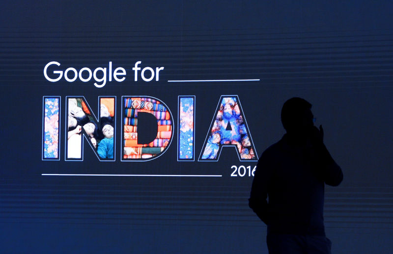 © Reuters. FILE PHOTO: Man stands in front of a screen during a Google event in New Delhi