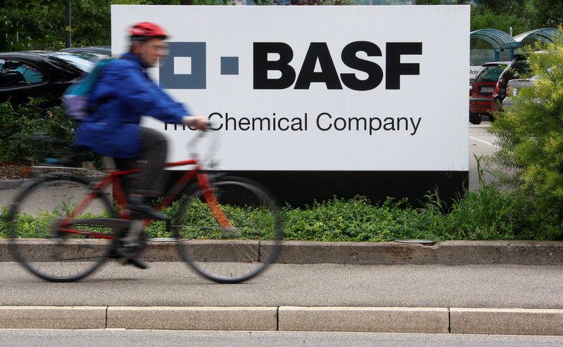 © Reuters. FILE PHOTO: A cyclist rides his bike bast the entrance of the BASF plant in Schweizerhalle