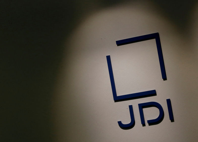 © Reuters. FILE PHOTO - Japan Display Inc's logo is pictured at its headquarters in Tokyo