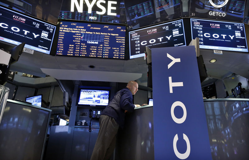 © Reuters. A trader works at the trading post that trades Coty Inc. on the floor of the New York Stock Exchange
