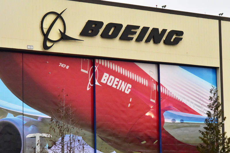 © Reuters. FILE PHOTO: Boeing Co's logo is seen above the front doors of its largest jetliner factory in Everett
