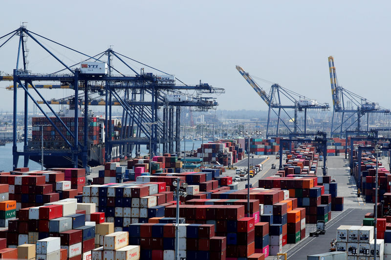 © Reuters. FILE PHOTO: Ship and containers are shown at the port of Los Angeles in Los Angeles, California