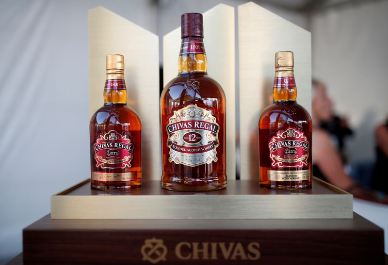 © Reuters. FILE PHOTO: Bottles of Chivas Regal blended Scotch whisky, produced by Pernod Ricard