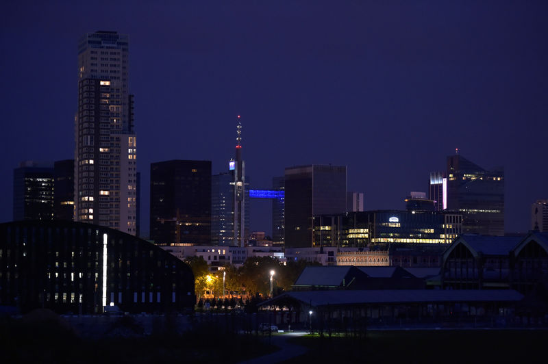 © Reuters. Night shot of illuminated city business district in Brussels
