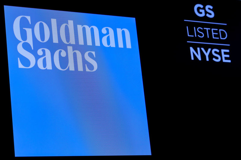 © Reuters. FILE PHOTO: The ticker symbol and logo for Goldman Sachs is displayed on a screen on the floor at the NYSE in New York