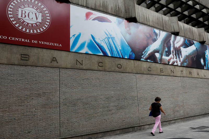 File Photo A Woman Walks Outside Of The Venezuela S Central Bank In
