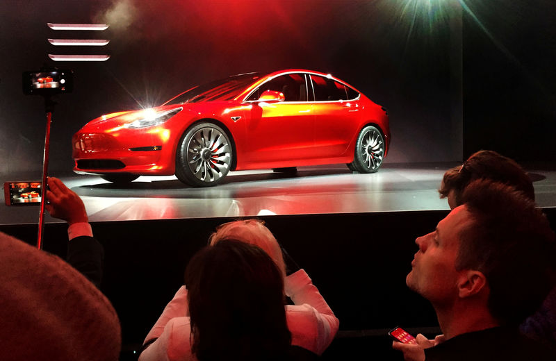 Tesla debuts $35,000 Model 3, sees loss in first quarter