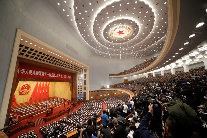 © Reuters. Delegates and journalists attend the National People's Congress (NPC) at the Great Hall of the People in Beijing