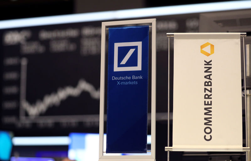 © Reuters. FILE PHOTO: Banners of Deutsche Bank and Commerzbank are pictured in front of the German share price index, DAX in Frankfurt