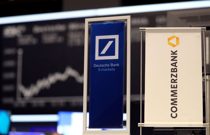 © Reuters. FILE PHOTO: FILE PHOTO: Banners of Deutsche Bank and Commerzbank are pictured in front of the German share price index, DAX in Frankfurt