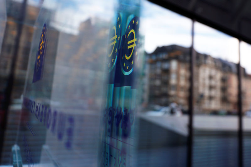 © Reuters. FILE PHOTO:  Reflection of the sign of the European central Bank (ECB) is seen ahead of the news conference on the outcome of the Governing Council meeting, at the ECB headquarters in Frankfurt