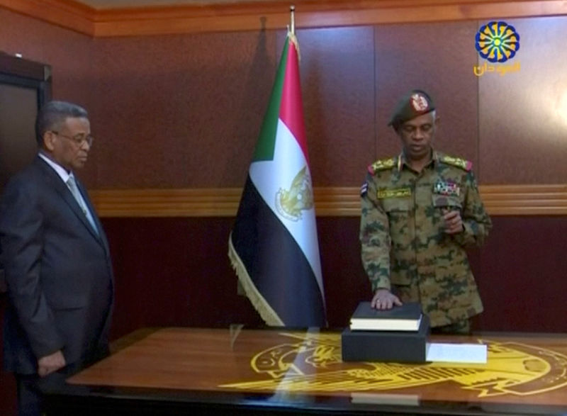 © Reuters. Sudan's Defence Minister Awad Mohamed Ahmed Ibn Auf is sworn in as a head of Military Transitional Council in Sudan