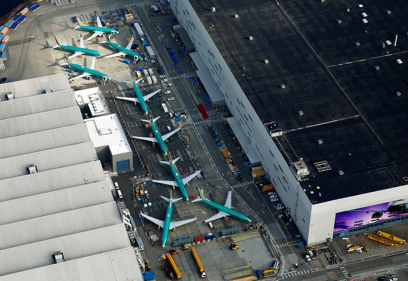 © Reuters. An aerial photo shows Boeing 737 MAX airplanes parked on the tarmac at the Boeing Factory in Renton