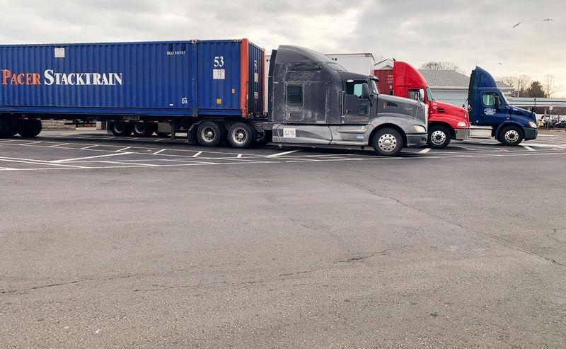 Truck drivers see orders, miles fall in latest U.S. slowdown signal