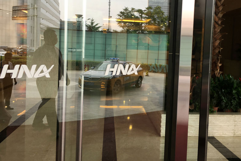© Reuters. The HNA Group logo is seen on the gate of HNA Plaza building in Beijing