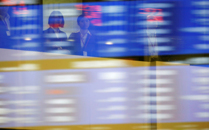 Stocks splutter as oil races to near six-month high