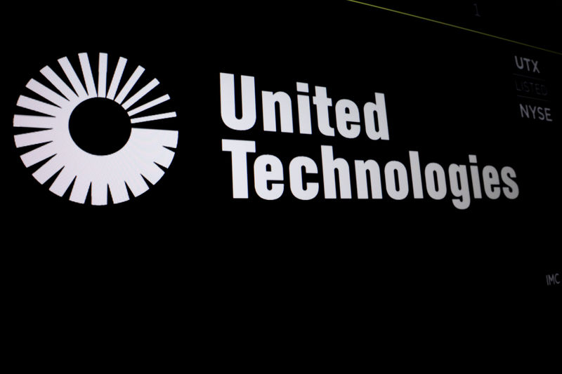 © Reuters. United Technologies logo is displayed on a screen at the post where it's stock is traded on the floor of the NYSE in New York