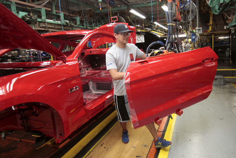 © Reuters. FILE PHOTO: A Ford Motor assembly worker works on a Ford Mustang vehicle at the Ford Motor Flat Rock Assembly Plant in Flat Rock, Michigan