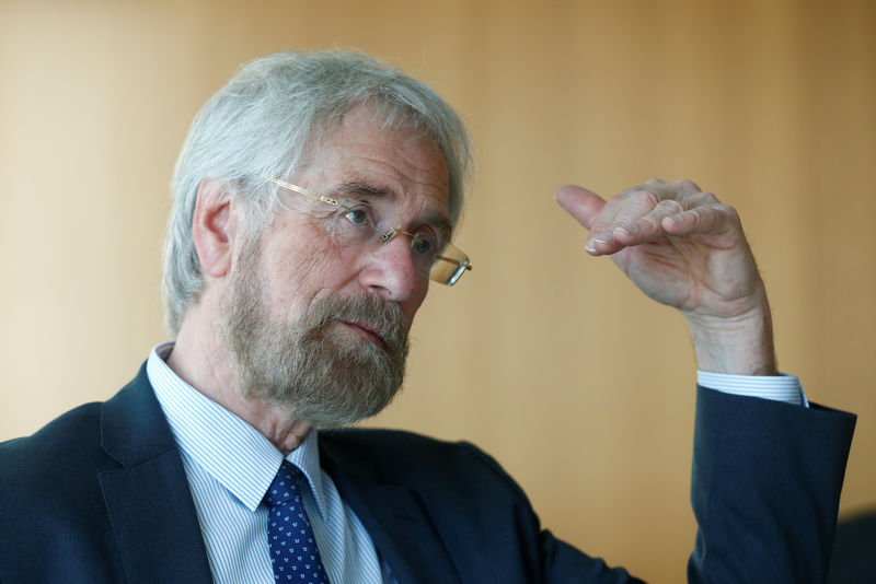 © Reuters. FILE PHOTO: European Central Bank (ECB) executive board member Praet speaks during an interview with Reuters in Frankfurt