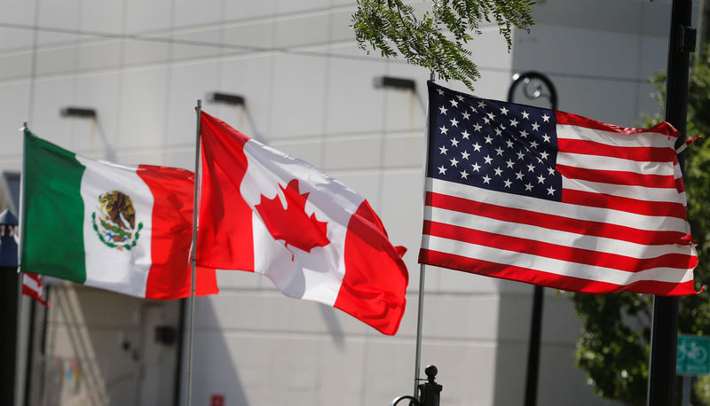 � Reuters. Flags of the U.S., Canada and Mexico fly next to each other in Detroit, Michigan