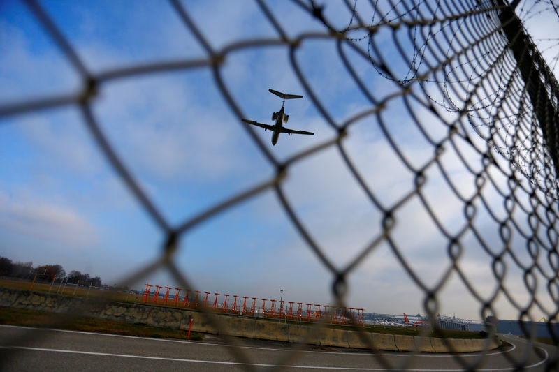 � Reuters. An airplane prepares to land at Cointrin airport in Geneva