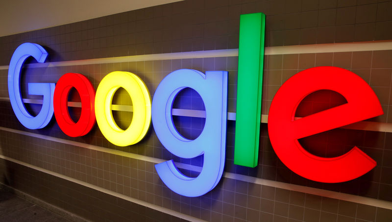 © Reuters. FILE PHOTO: a Google logo illuminated inside and an office building in Zurich