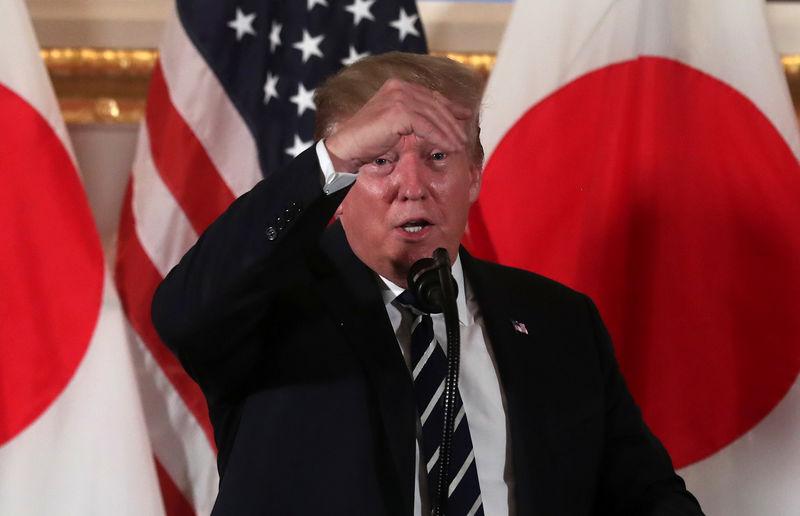 Trump arrives in Japan for ceremonial visit as trade tensions loom