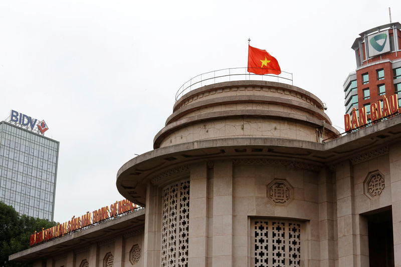 © Reuters. A Vietnamese flag flies atop the State Bank building in central Hanoi