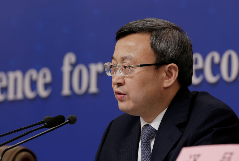 © Reuters. FILE PHOTO: Chinese Vice Commerce Minister and Deputy China International Trade Representative Wang Shouwen attends a news conference during ongoing session of the NPC in Beijing