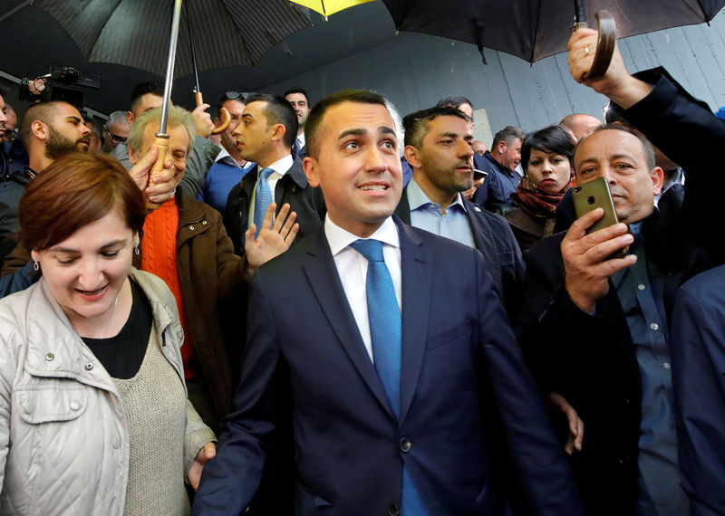 © Reuters. FILE PHOTO: Italian Deputy Prime Minister and 5-Star Movement leader Luigi Di Maio leaves after casting his vote in the European election