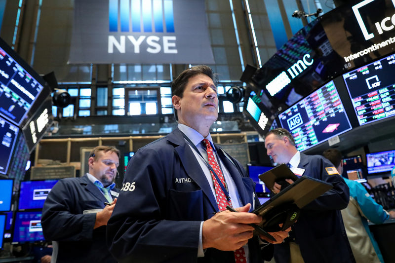 Global stocks rally, and yields, dollar fall; data fans rate cut talk