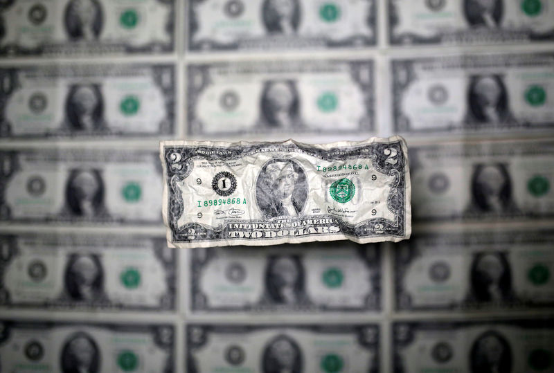 © Reuters. U.S. dollar banknote is seen in this picture illustration