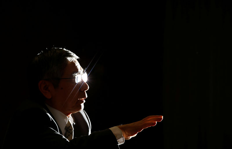 © Reuters. FILE PHOTO: Bank of Japan Governor Kuroda speaks during a group interview at the BOJ headquarters in Tokyo