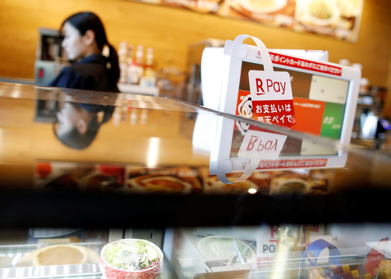 Hoping to boost spending, Japan tries to sell shoppers on cashless purchases