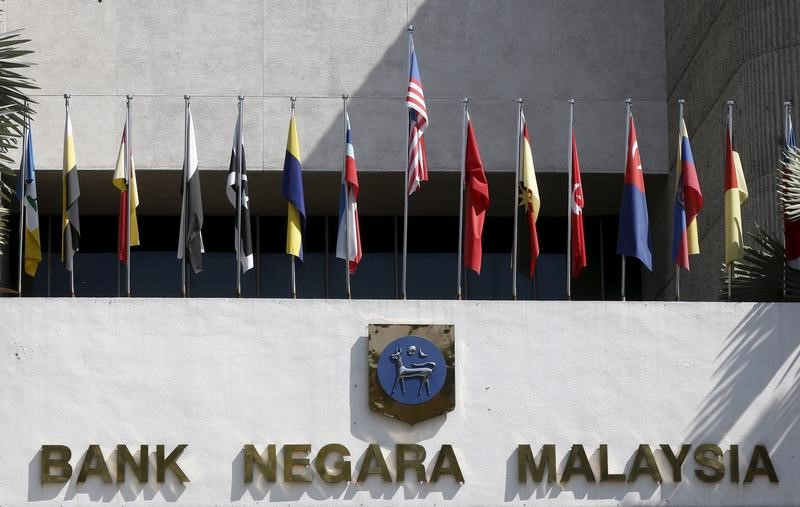 Malaysia's central bank seen holding rates to assess economic risks: Reuters poll