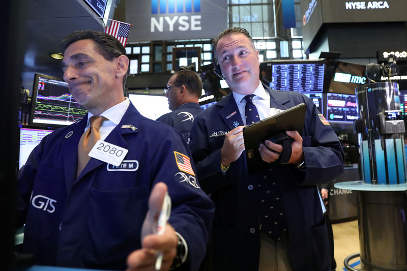 Wall Street slips as bank earnings, Trump trade comments weigh By Reuters