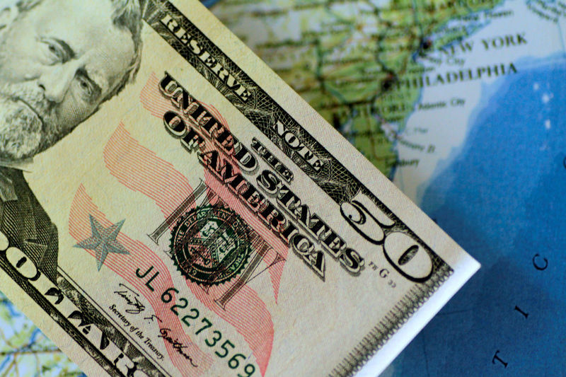 Dollar clings to gains as Gulf tensions bolster safe-haven bid