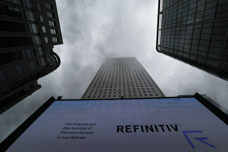 © Reuters. An ad for Refinitive can be seen on a screen in London's financial center Canary Wharf